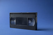 Close-up of a VHS videocassette on blue background