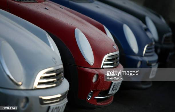 Frost gathers on the bonnets unsold Mini cars outside a dealership on December 7 2008 in Bath England Mini owner carmaker BMW has announced an...
