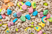 Frosted toasted oat cereal with fun shaped marshmallows on white background.