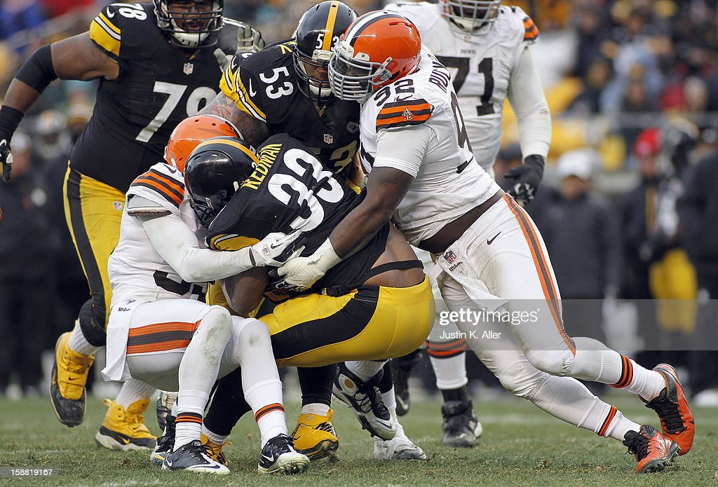 Frostee Rucker #92 of the Cleveland Browns tackles Isaac Redman #33 of the Pittsburgh Steelers during the game on December 30, 2012 at Heinz Field in Pittsburgh, Pennsylvania. The Steelers defeated the Browns 24-10.