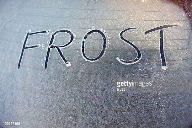 Frosty car window with word frost written on it