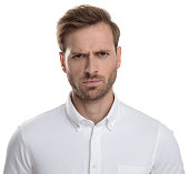 frown young casual man on white background