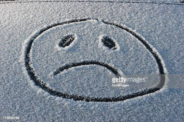 A frowny face has been drawn in the snow