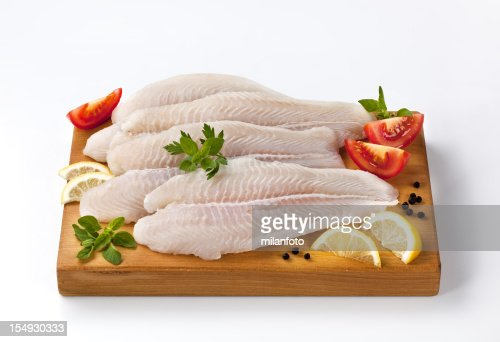 Frozen fish fillets on a cutting board