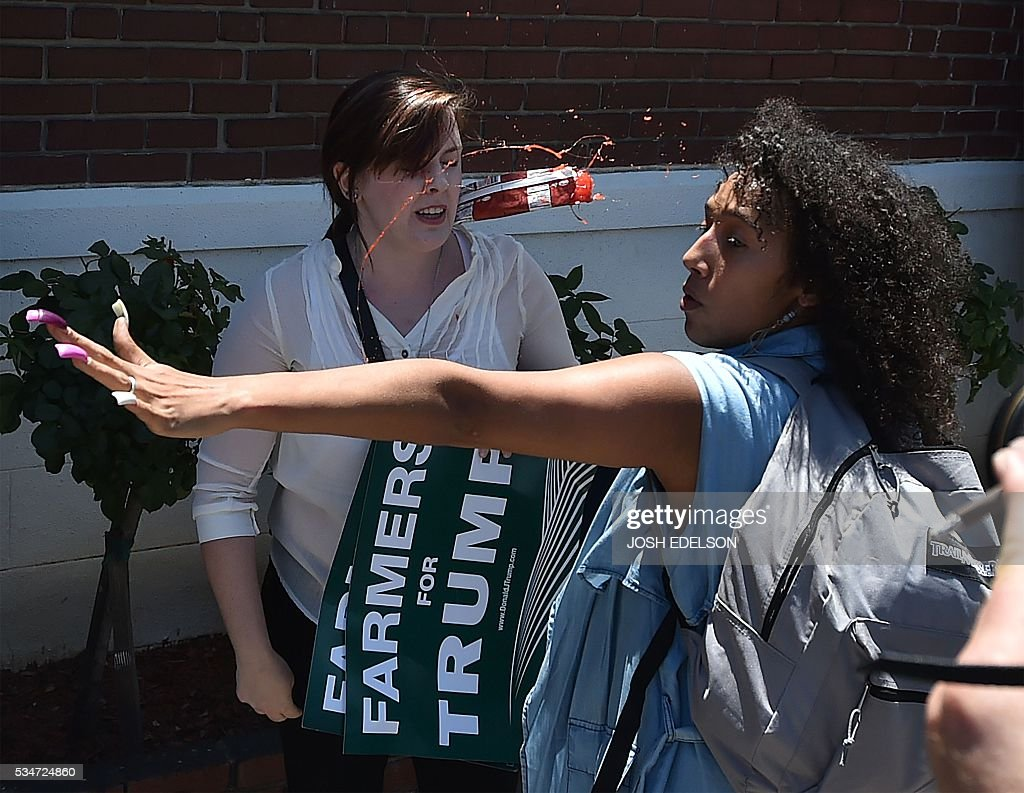 A frozen food item hits a girl in the face after republican presidential candidate Donald Trump finished speaking at a nearby rally in Fresno, California on May 27, 2016. / AFP / JOSH