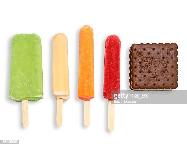 Frozen fruit juice pops and ice cream sandwich