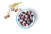 Frozen grapes cluster with ice on white background