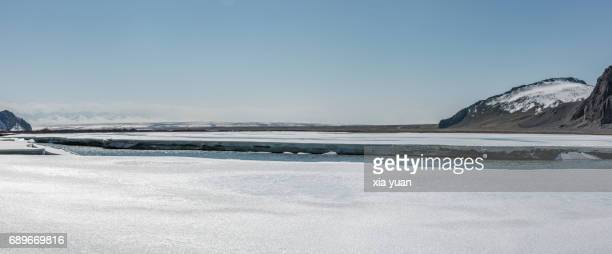 Frozen ice sheet over river melting with spring thaw,Bayanbulak,China