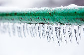 Frozen icy down pipe, icicles