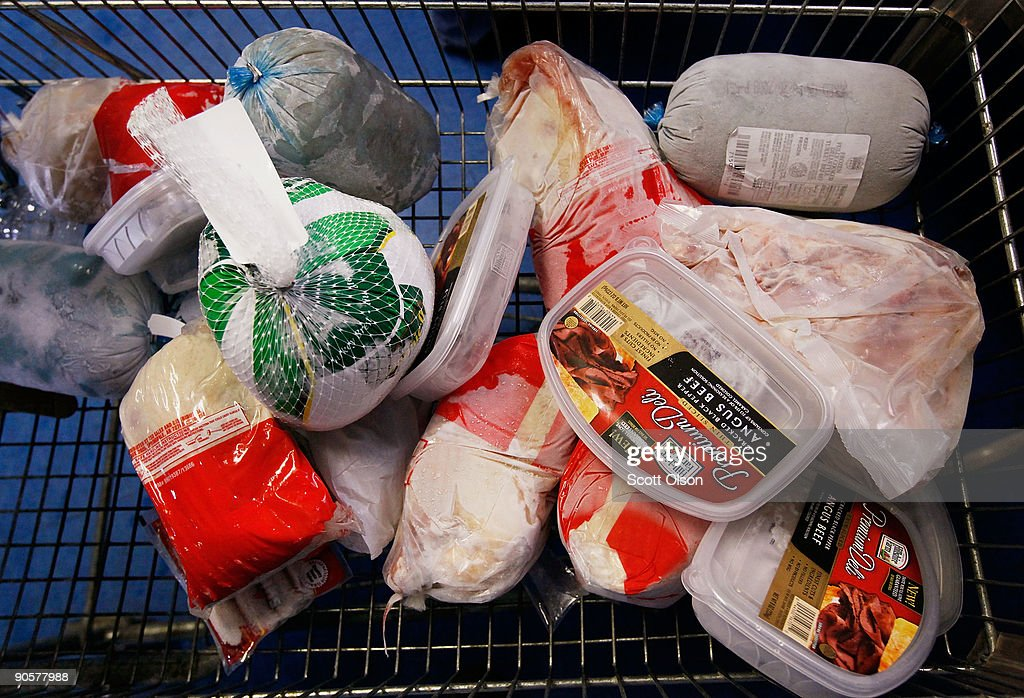 Frozen meat which will be given away to needy people sits in a shopping cart at Elijah's Pantry September 10, 2009 in Chicago, Illinois. According to a government report released today the nation's poverty level jumped to an 11-year high in 2008 as household incomes sank and the number of people without health insurance rose. Elijah's food pantry has seen the number of food baskets it gives away each month climb from 300 to 500 in the past year.