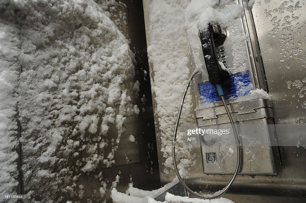 Frozen public phone after winter storm Nemo covered New York City with 4 to 8 inches (10-20cms) of snow on February 9, 2013. The storm was forecast to bring the heaviest snow to the densely-populated northeast corridor so far this winter, threatening power and transport links for tens of millions of people and the major cities of Boston and New York. New York and other regional airports saw more than 4,500 cancellations ahead of what the National Weather Service called 'a major winter storm with blizzard conditions' along most of the region's coastline.