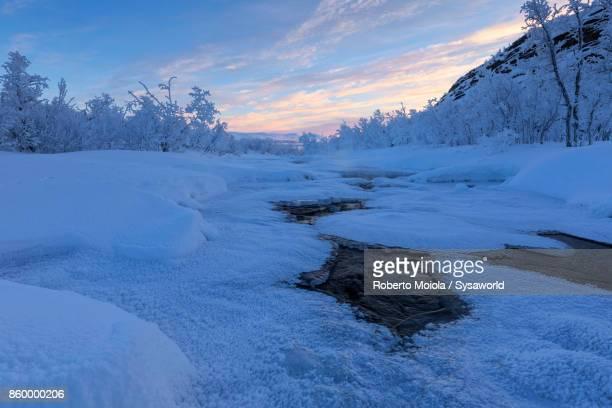 Frozen river at sunrise, Abisko, Sweden