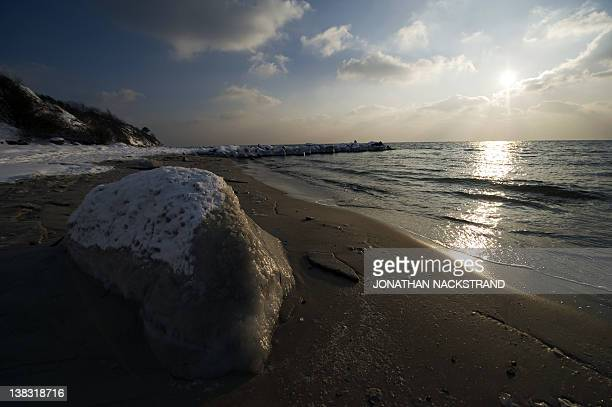 Frozen seawater covers a rock on February 5 2012 on the shore near the city of Ronne on the Danish island of Bornholm in the Baltic Sea The deadly...