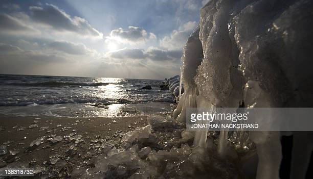 Frozen seawater covers on February 5 2012 the shore near the city of Ronne on the Danish island of Bornholm in the Baltic Sea The deadly cold snap...