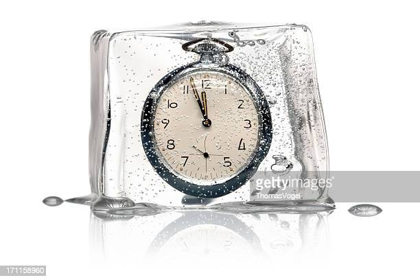 Frozen Time Concept - Clock Ice Cube retro