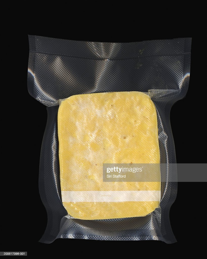 Frozen vacuum sealed block of macaroni and cheese