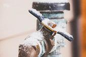 Frozen water shut off handle in snowstorm