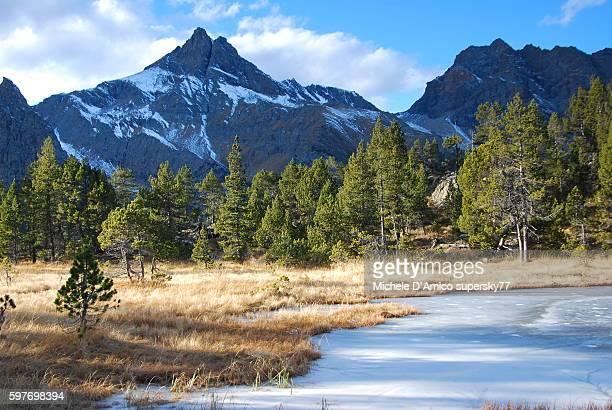 Frozen wetland and high peaks.