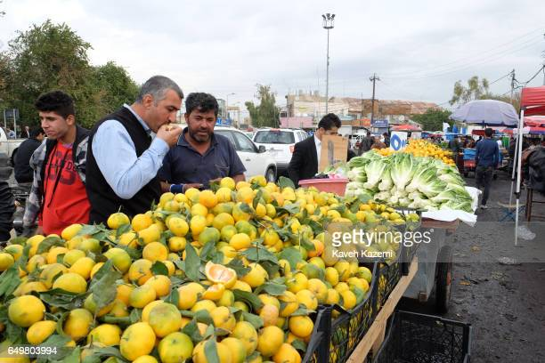 Fruit and green grocery vendors in the market place near the citadel on November 2 2016 in Erbil Iraq Erbil also spelt Arbil or Irbil is the capital...