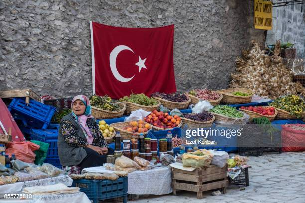 Fruit and vegetable stall and turbaned woman seller, Safranbolu, Karabuk, Turkey