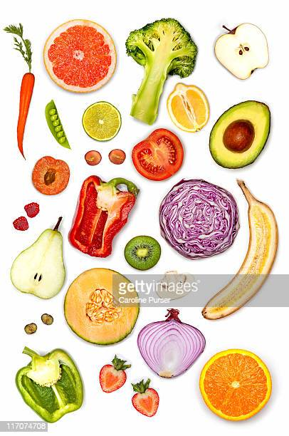 Fruit and vegetables cut in half, white background