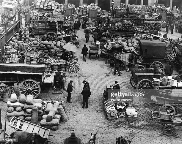 Fruit and vegetables on sale at Covent Garden market in London circa 1910