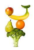Various fruit and vegetables arranged to symbolise a balanced diet