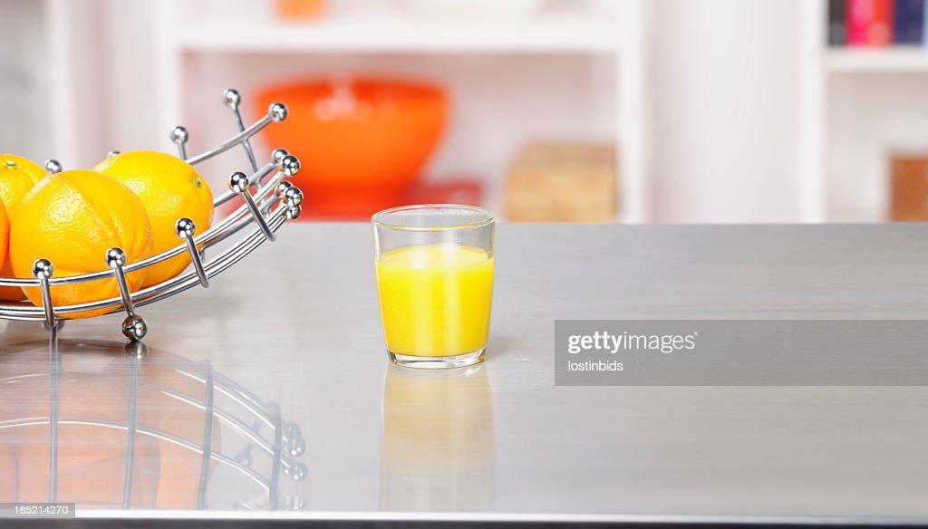 Fruit Basket  And Orange Juice On A Kitchen Workshop