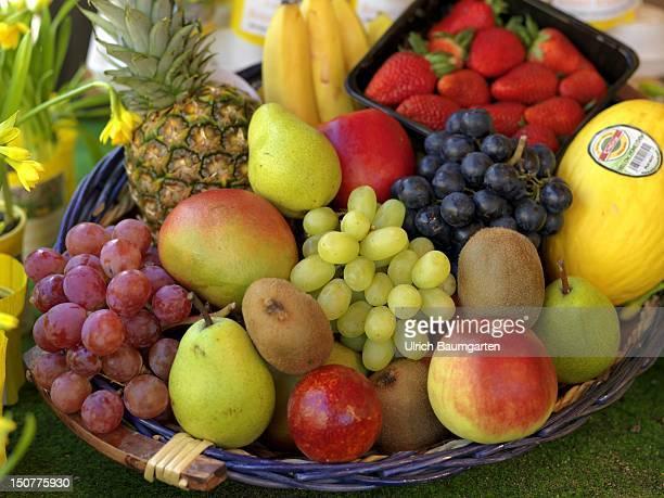 GERMANY BONN Fruit basket with grapes pears apples kiwis pineapples bananas melon strawberries and mango [digital medium format photography]