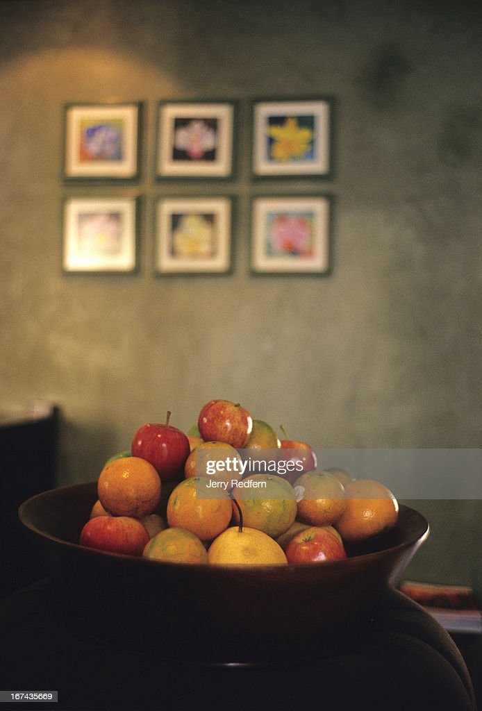A fruit bowl in the lobby area of the Baan Tazala Hotel in Chiang Mai. The high-end boutique hotel mixes old and new Thai and European styles..