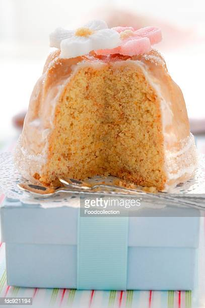 Fruit cake with sugar flowers on pale-blue box
