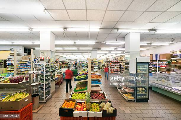 Fruit department in a small italian supermarket with neon lights