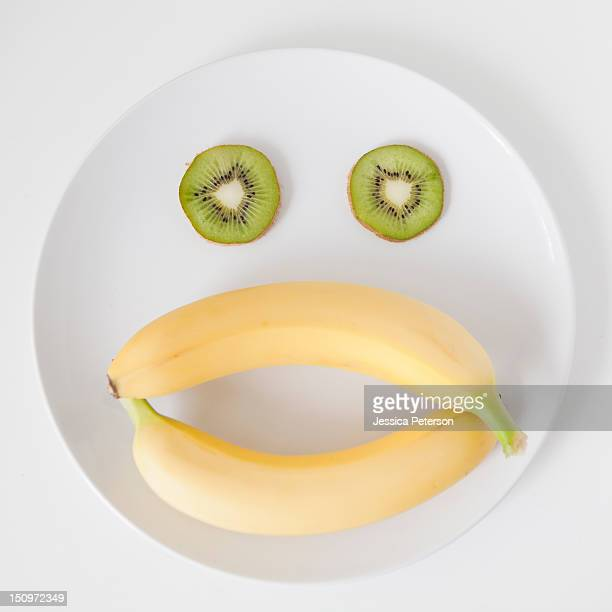 Fruit face on plate, studio shot