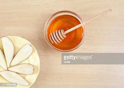 Fruit getting served with honey in glass bowl