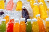 Fruit Juice Bottles in ice.
