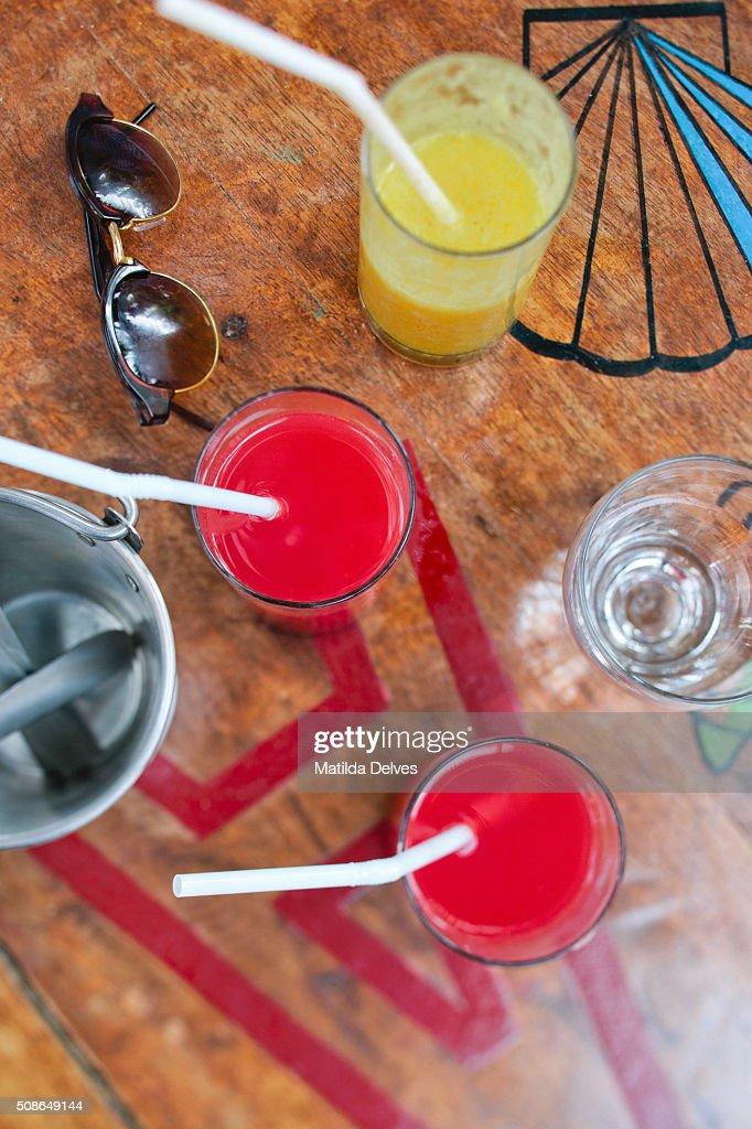 Fruit juice on a wooden table, Goa, India : Stock Photo