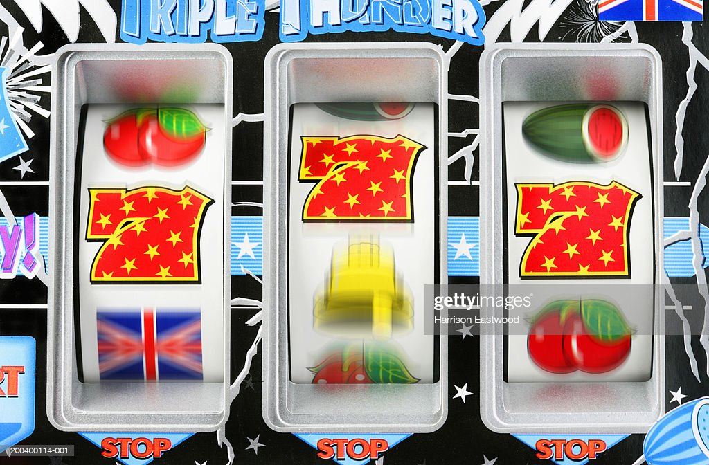 Fruit machine bars spinning to line of 7's, close-up (blurred motion) : Stock Photo
