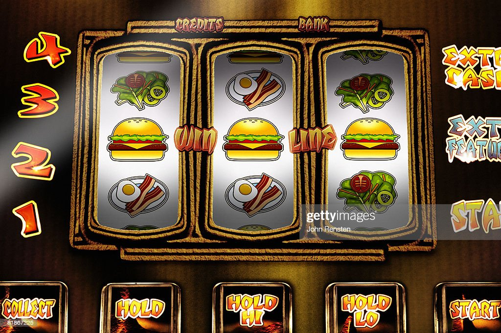 Fruit machine with health/diet issued reels : Stock Photo