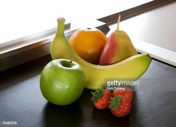 Fruit on supermarket conveyor belt