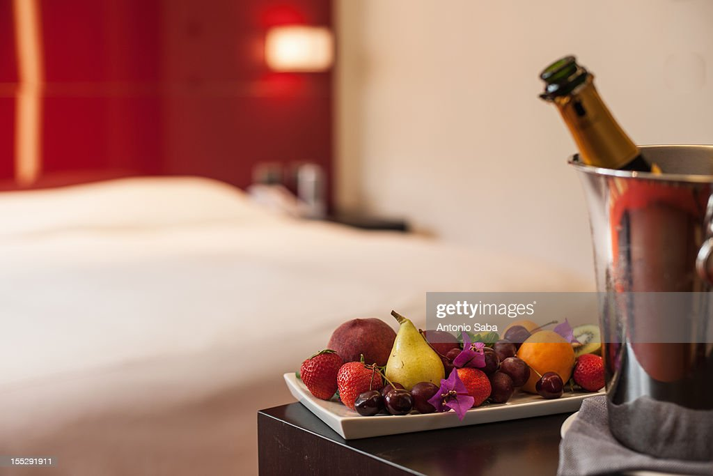 Fruit plate and champagne in hotel room