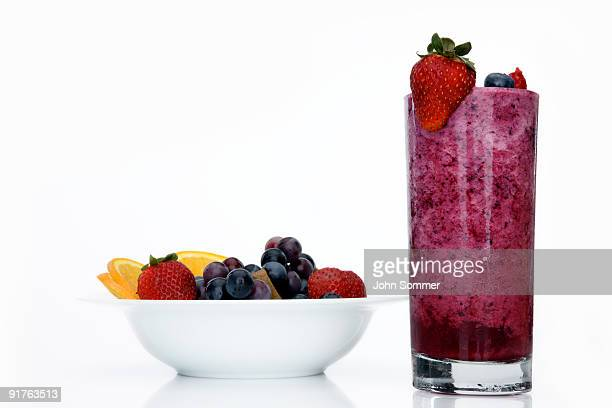 Fruit salad along with a smoothie