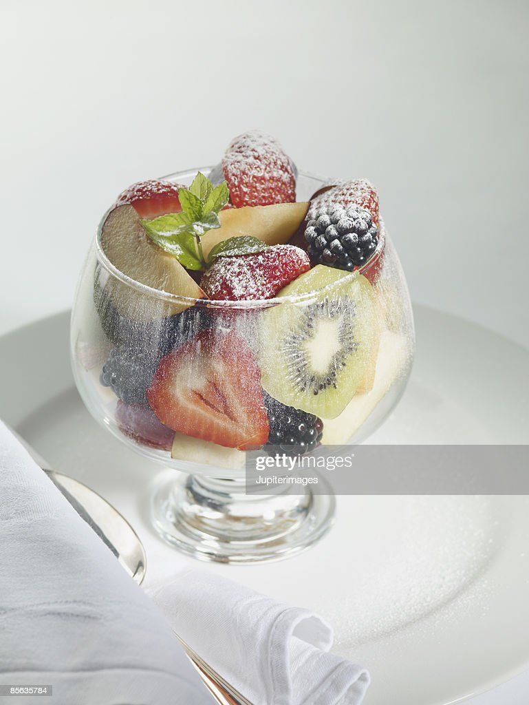 Fruit salad with powdered sugar : Stock Photo