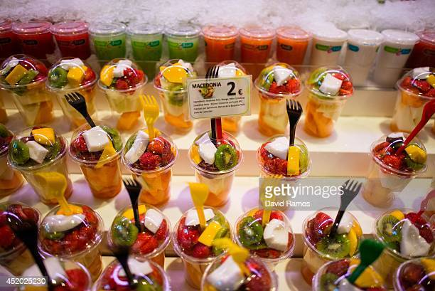 Fruit salads are seen for sale at 'La Boqueria' green market on July 11 2014 in Barcelona Spain As traders of 'La Boqueria' complain about tour...