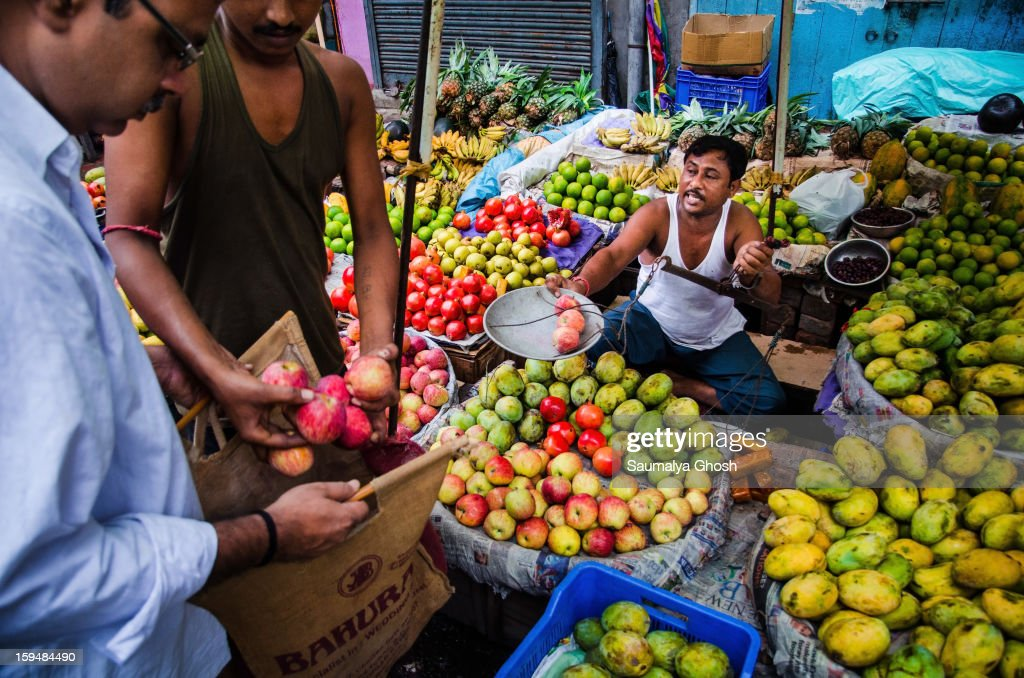 CONTENT] A fruit seller is busy with his business on the streets of Kolkata.