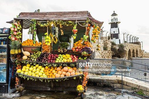 Fruit seller kiosk and the lighthouse : Stock Photo