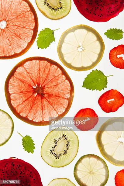 Fruit slices on white background