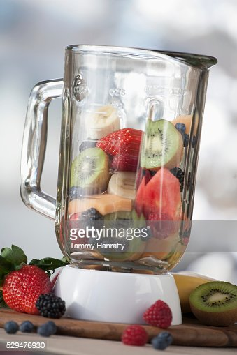 Fruit smoothy contents in a blender : Bildbanksbilder