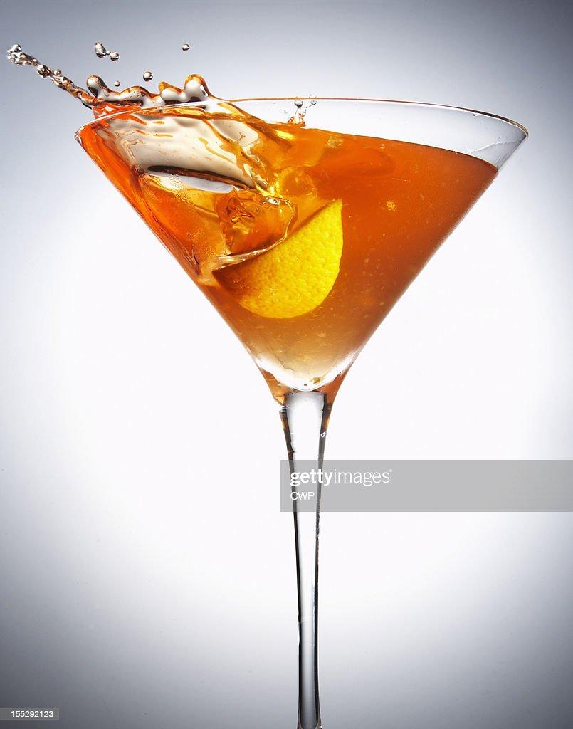 Fruit splashing in cocktail glass : Stock Photo