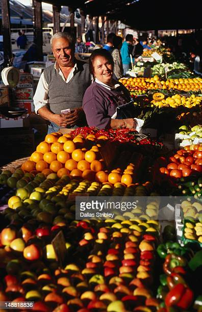 Fruit stall vendors at Melbourne's famous Queen Victoria Market.