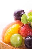 Fruit tart, close up, white background